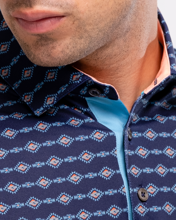 Navy blue breathable polo with orange and turquoise tribal print and peach inner collar