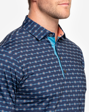 Navy blue breathable polo with orange and turquoise tribal print and peach inner collar with four button placket