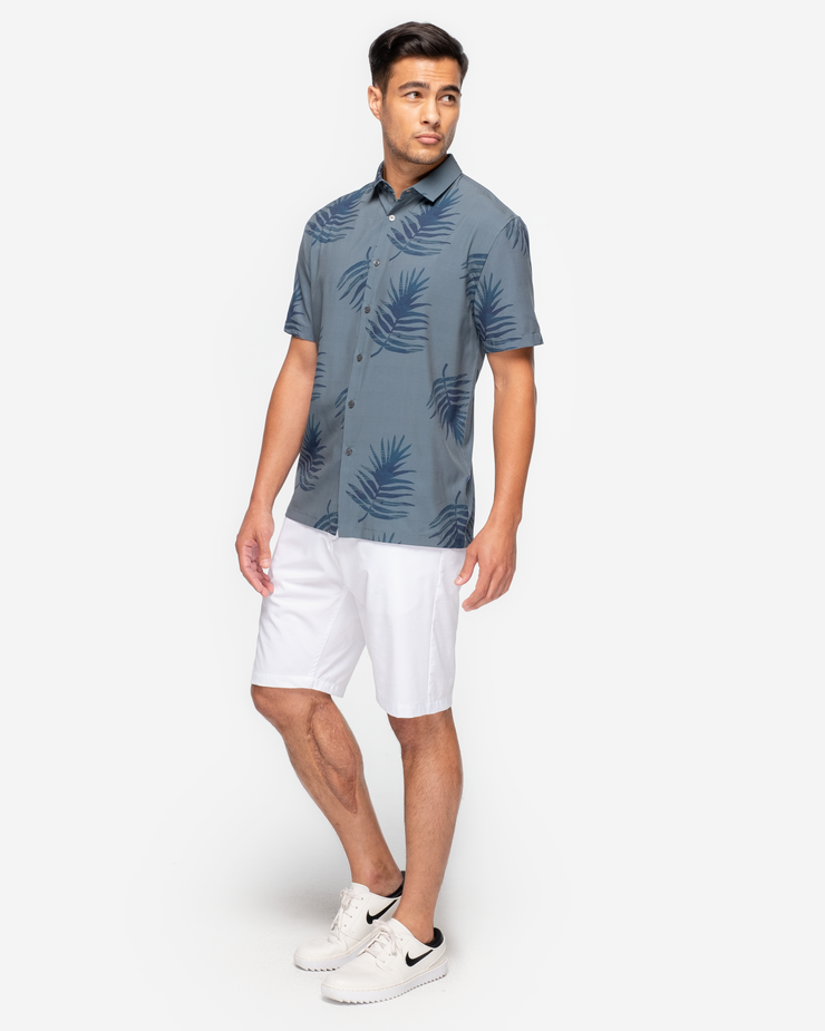 Green-Blue lightweight short sleeve button down with navy blue allover palm print paired with white shorts