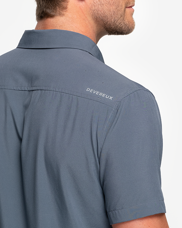 "Solid Dark grey collared short sleeve button down with left chest pocket and right shoulder ""devereux"" logo"