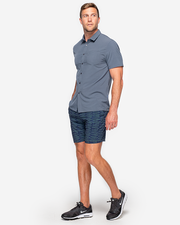 Solid Dark grey collared short sleeve button down with left chest pocket paired with blue graphic shorts