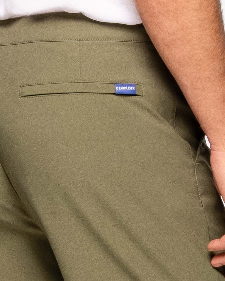 "Olive army green active short with black drawstring elastic wasteband and blue ""Devereux"" tag on back pocket"
