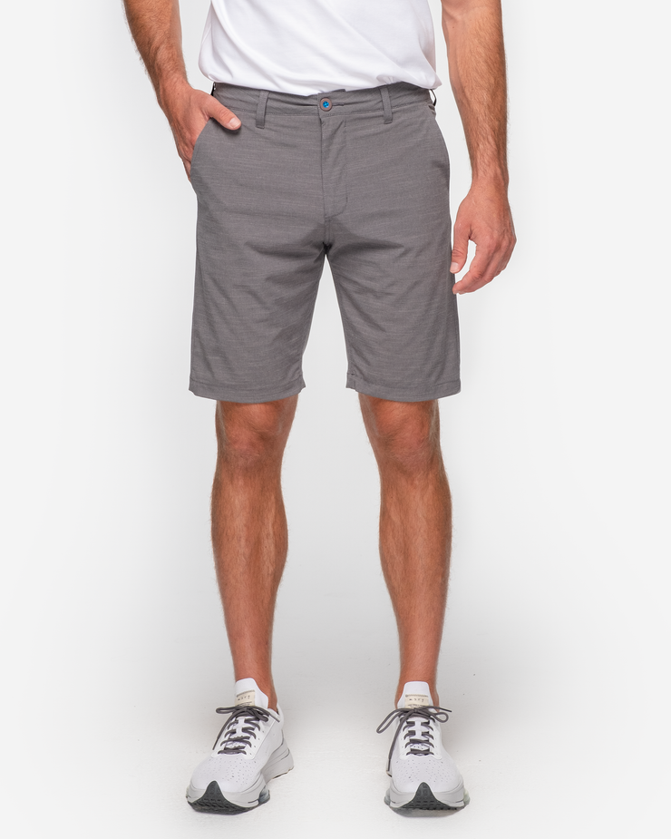 Dark grey textured golf shorts with with blue accent button