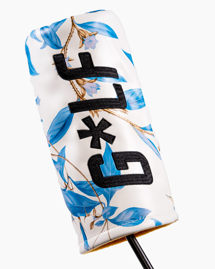 White leather headcover with all-over blue hawaiian floral print with G*LF logo on side and orange interior