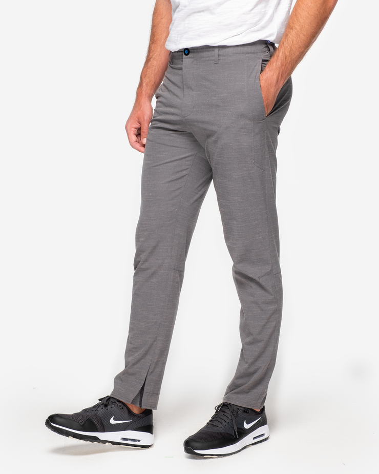 Dark grey textured black trouser with zip ankle