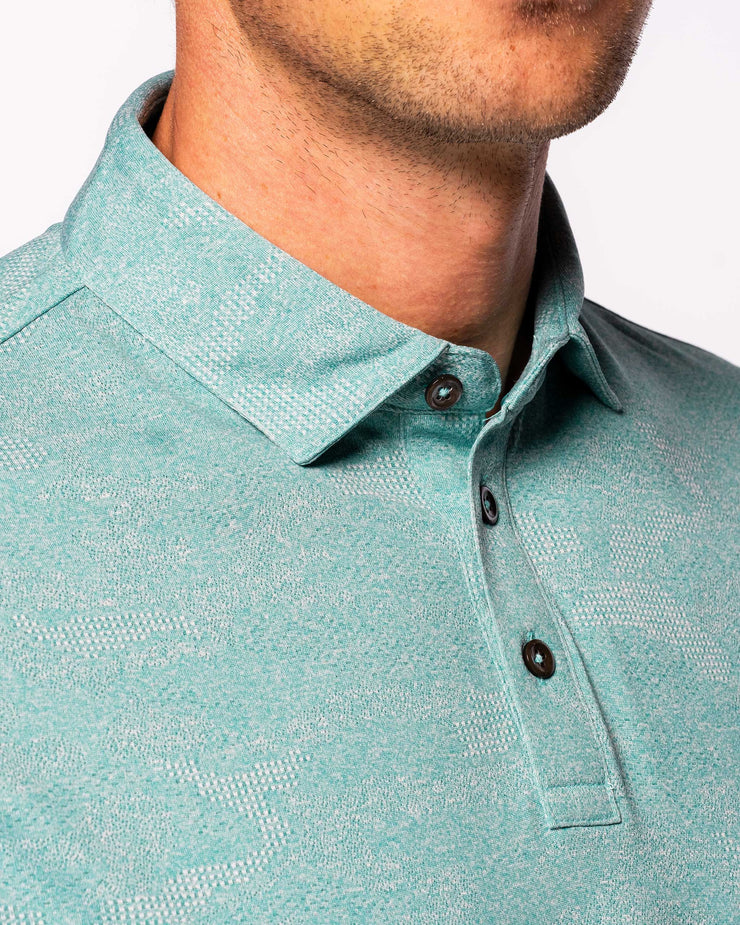Green-blue lightweight polo with subtle camo design and 3 button placket