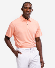 Orange peach coral lightweight polo with subtle camo design and three button placket piared with white shorts