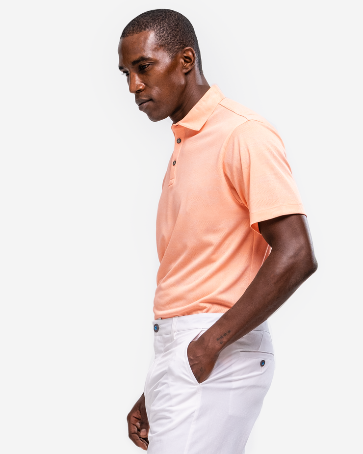 Orange peach coral lightweight polo with subtle camo design and 3 button placket