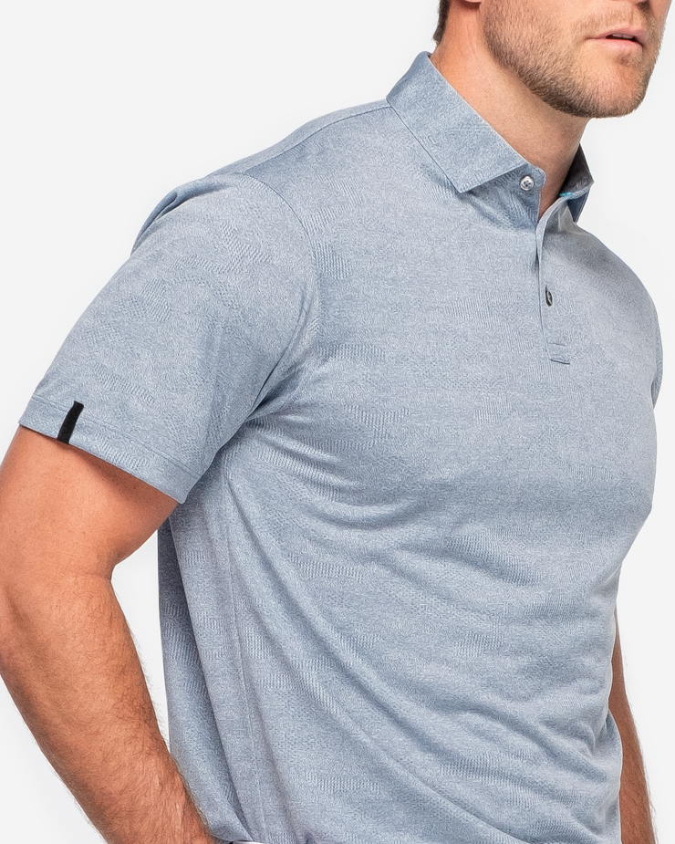 Blue lightweight polo with subtle camo design and three button placket