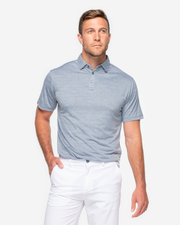 Blue lightweight polo with subtle camo design and three button placket paired with white shorts
