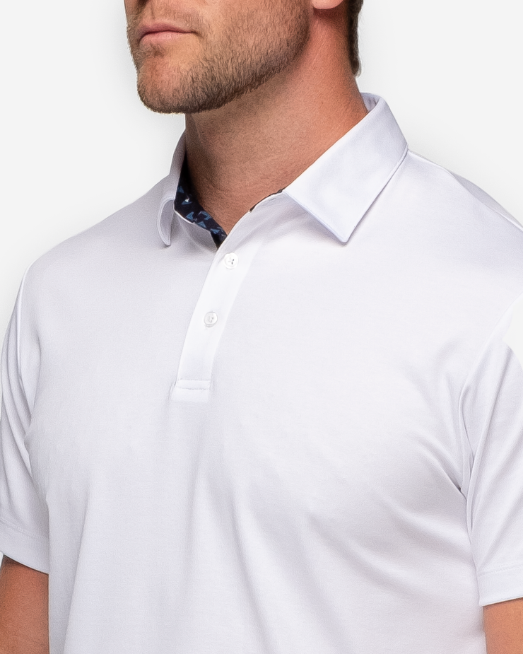Classic white Devereux golf polo with blue and black inner collar detail