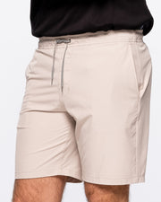 Khaki active short with black and white zig zag drawstring and zipper pocket