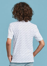 Kids white polo with all-over navy blue cactus print and contrasting three button placket