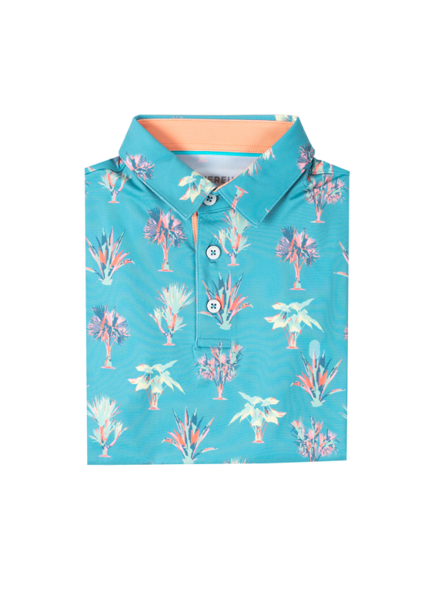 Kids bright blue performance polo with palm print pattern and peach orange inner collar detail