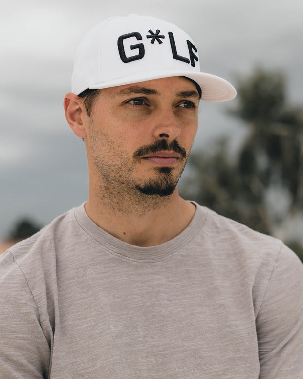 man with white hat with black G*LF design