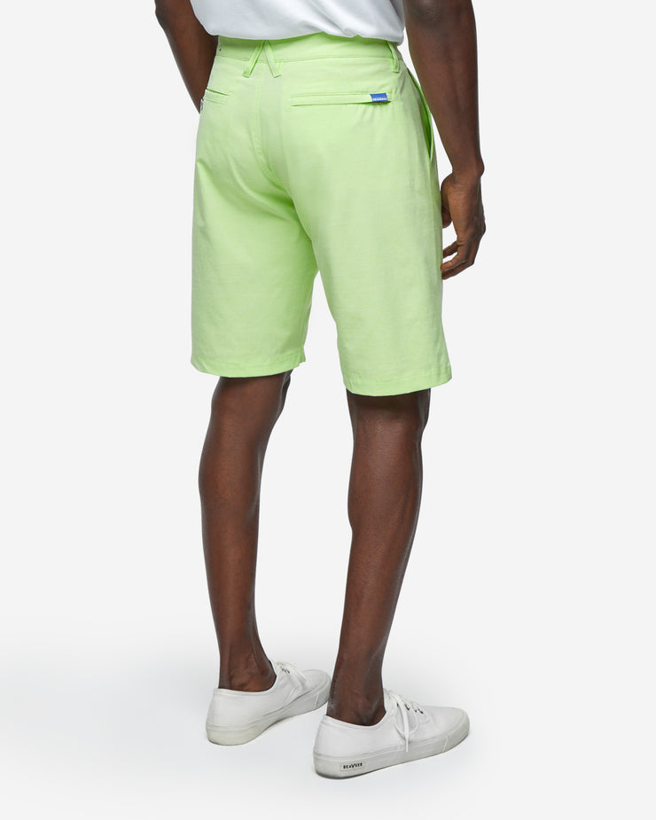 Lime neon green golf shorts with with blue accent button