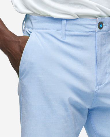 Light blue golf shorts with with blue accent button