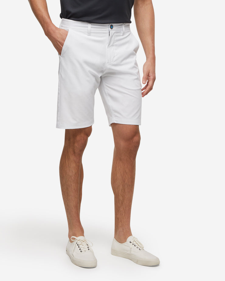 White golf shorts with with blue accent button