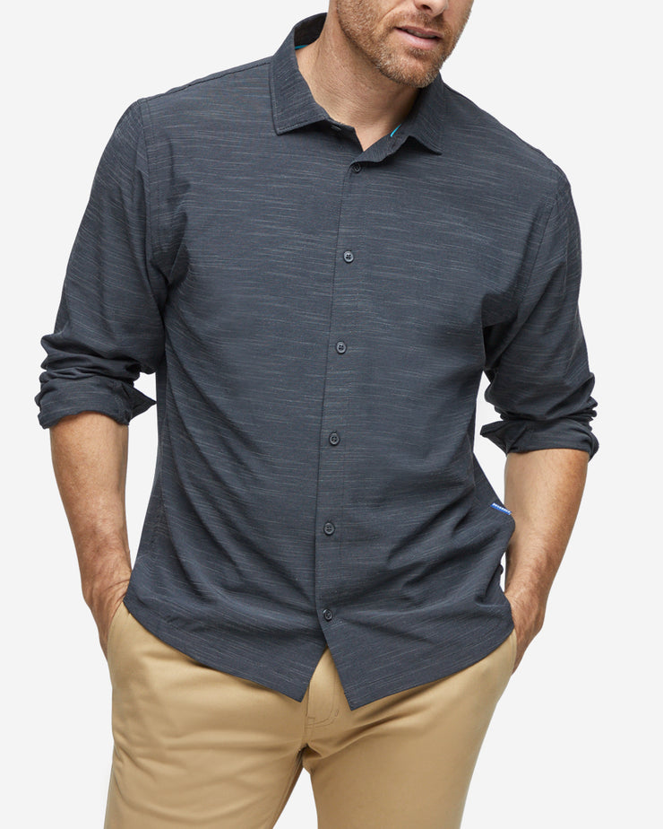 Heather black textured breathable and stretchy long sleeve button down paired with khaki pants