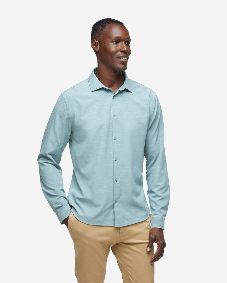 Green-grey breathable and stretchy long sleeve button down paired with khaki pants