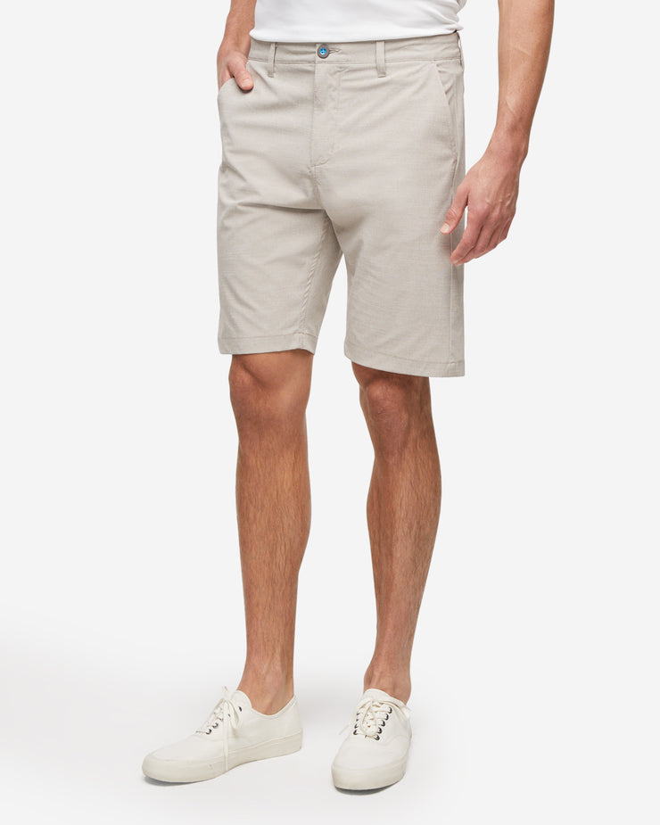 Khaki textured golf shorts with with blue accent button