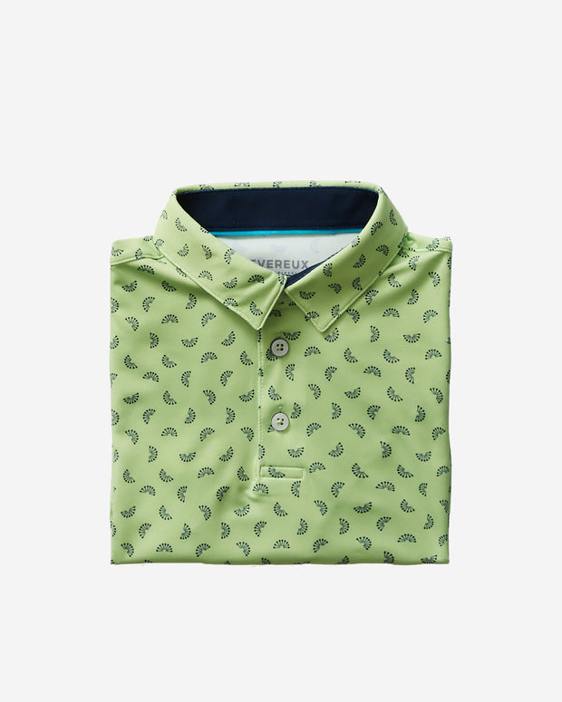 Kids lime green polo with all-over navy citrus wedge print and three button placket