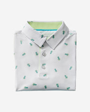 Kids white polo with an all-over blue and green pineapple print and inner green three button placket