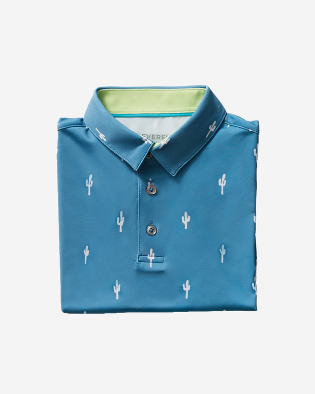 Kids blue active polo with all-over white cacti print and three button placket