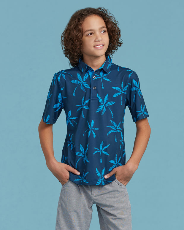 Kids dark blue polo with all-over large palm tree print and three button placket