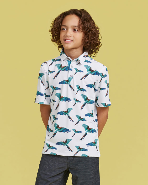Kids white polo with all-over turquoise tropical bird photo print and three button placket