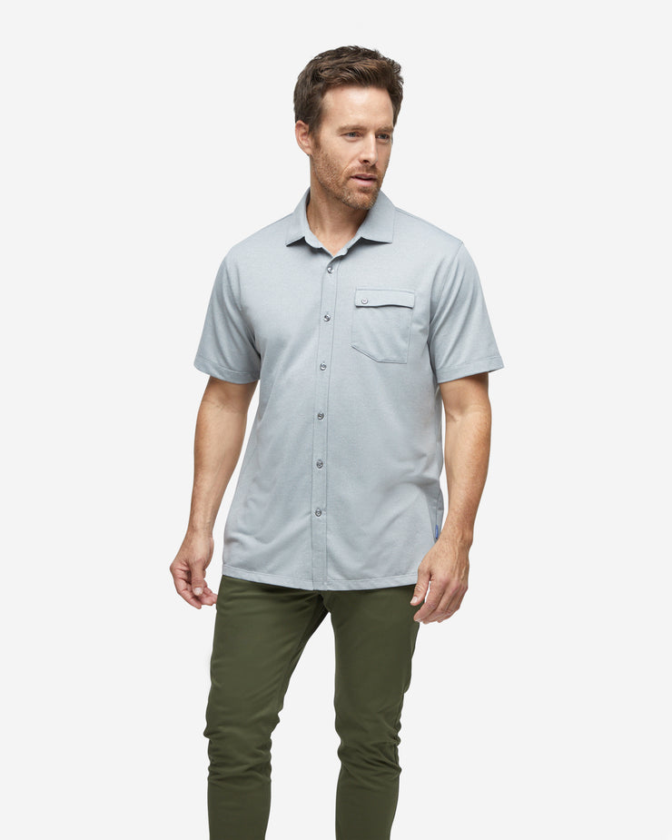 Grey textured short sleeve button down with asymmetric left chest pocket with button paired with army green pants