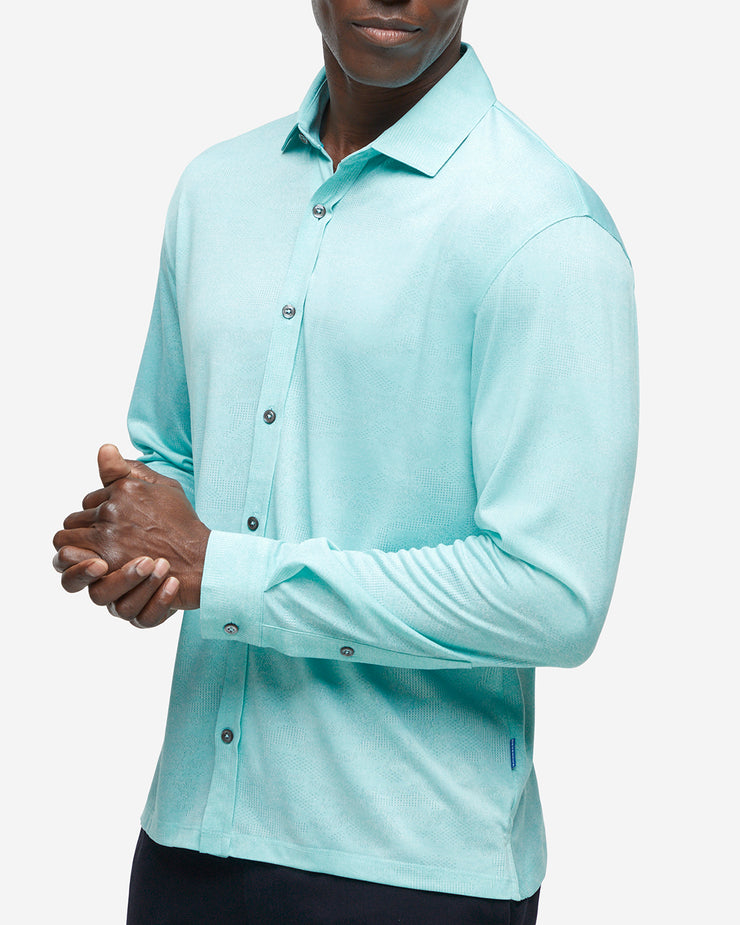 Turquoise blue performance jersey long sleeve button down with subtle mesh camo design