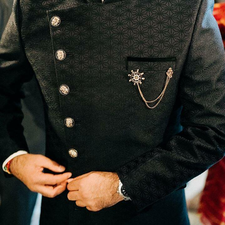 Black silk Sherwani designed and handcrafted perfectly for an Indian groom