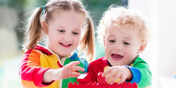 block activities for toddlers-block play-two toddlers playing with colorful blocks