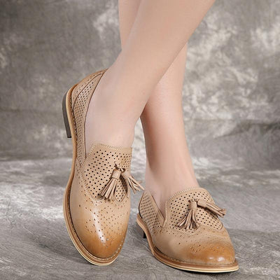 Vintage Solid Color Hollow Tassel Round Toe Low Heel Leather Loafers