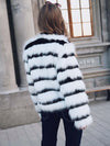 2019 autumn and winter new women's fur coat European and American wind plush female models imitation fox hair Slim warm coat