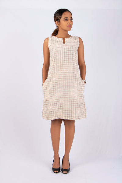 Simple shift dress in kotpad Khadi red checks khadi shift dress Natural dyed khadi  Khadi formal shift dress Sustainable fashion brand Slow Fashion brand The Kaatn Trail Khadi western wear for women Khadi dress online for women Khadi products Natural dye clothing brand khadi women's wear khadi clothes for ladies