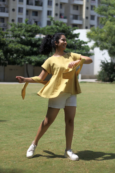 Hand-spun, hand-woven top, khadi top for women online Natural dyed using pomegranate peels Boat Neck Cap sleeves With broad self-fabric belt Flared style for easy fit Fruit Dyed comfortable western casual top mustard color cotton top frock style top khadi natural dyed top Pomegranate Dye Sustainable fashion Slow fashion