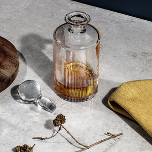 Cló Whiskey Decanter - A crystal decanter inspired by the markings of ogham script, the early Irish alphabet. The Cló whiskey decanter is part of a range of fine contemporary cut crystal glassware featuring elegant linear cuts. Cló[n. Script, type, print] Width 105mm, Height 200mm