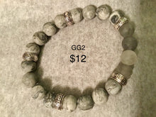 Load image into Gallery viewer, Various grey men/unisex bracelets. Note: You will not be able to add to cart. Please contact me for ways to order.  Press 1st pic to reveal arrow or swipe to the right or upward to see more bracelets.