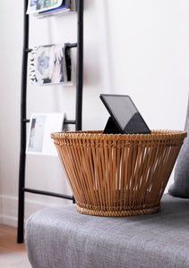 Pako table in bamboo, small table in a sofa with a tablet on. Pako small bamboo table that stands in a gray sofa with an ipad on.