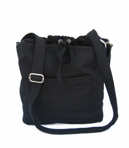 the Black bag in fabric with leather details. A black fabric bag with leather details