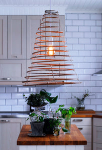 Wish lamp in rattan hanging in a Swedish kitchen
