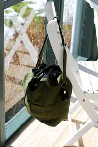 The Green bag hanging on a chair in the sunshine
