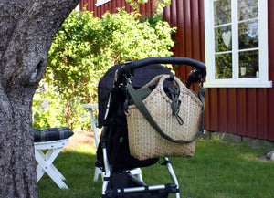 Pako stroller bag in bamboo on a stroller