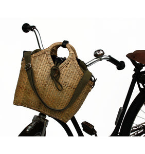 Pako bamboo bicycle bag and the Green bag in fabric attached to the handle of an old bicyle