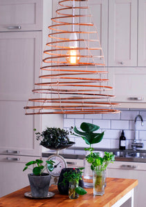 Wish lamp handmade in rattan hanging in the kitchen.