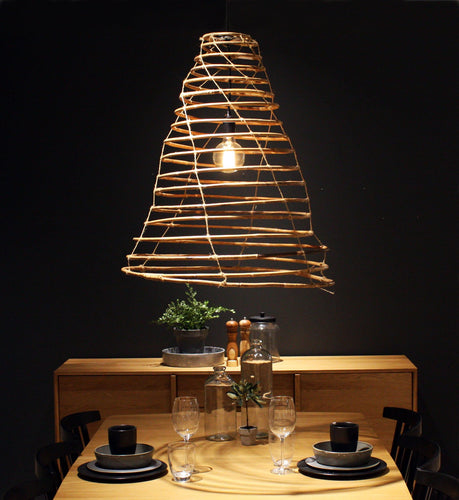 Wish handmade lamp in rattan over a dinner table.