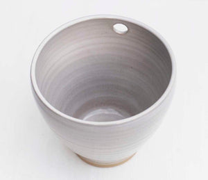 Single cup handmade ceramic cup with a hole