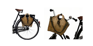 Pako stroller bag and bicycle bag handmade in bamboo. Pako bicycle bag / bag handmade in bamboo, attached to a black bicycle on the handlebars and on the package holder